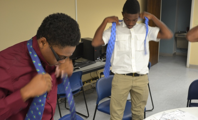 Tre and Tyrin tying  ties